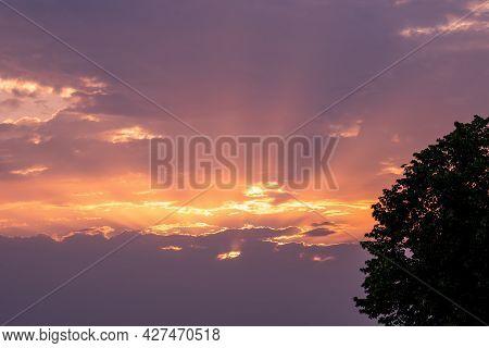 Moody Orange Sunset Between The Clouds Sky