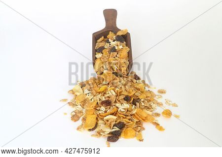 Healthy Cereal Breakfast. Mixed Muesli In Wooden Scoop Isolated On White Background.