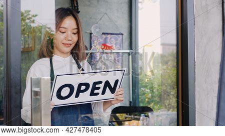 Happy Asian Beautiful Young Woman Staff Turning Round Sign To Open On Door, Female Owner Of Coffee S