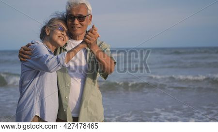 Happy Asian Senior Man And Woman Couple Smile Dancing Resting Relax On The Beach Honeymoon Family Su