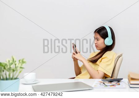 Asian Woman Happy Cute Beautiful Using Phone For Listening To Music With Earphones.