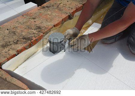 Insulating Floor In A Bathroom. A Building Contractor Is Installing Rigid Foam Board Insulation Over