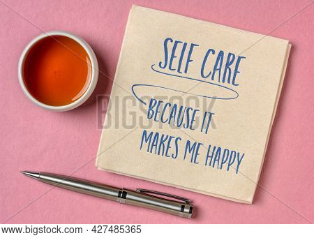 self care, because it makes me happy -  inspirational reminder,  handwriting on a napkin, lifestyle and health concept