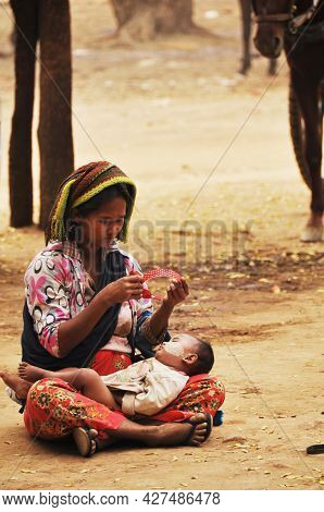 Burmese Mother And Son Daughter Baby Beggar Sitting And Begging Money From Burma People And Foreign