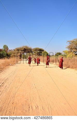 Burmese Children Boys Novice Group Playing Walking On Gravel Dirt Dust Road Go To Shwezigon Pagoda P