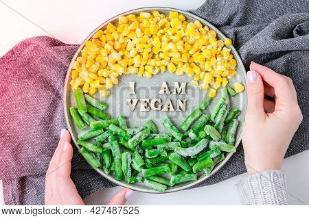 Female Hands Hold I Am Vegan Text In Plate. Veganism, Vegetarian Healthy Lifestyle Green Beans Yello