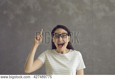 Young Smart Clever Caucasian Woman In Eyeglasses Having Idea Studio Shot