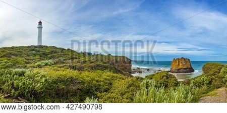 Panorama of a famous Split Point Lighthouse and Eagle Rock in the sea. Aireys Inlet at Great Ocean Road on southern coast of Victoria state, Australia.