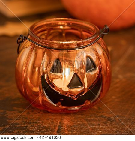 Halloween Pumpkin Head Jack Glass Lantern. Halloween Decoration On Wooden Table Background, Selectiv