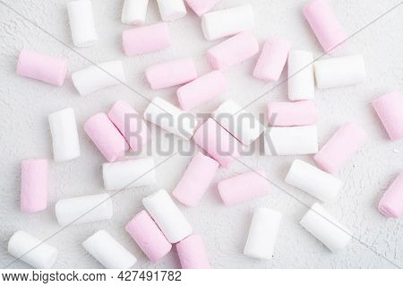 Marshmallow Candies On A White Background . Sweets. Candy Background. Copy Space . High Quality Phot