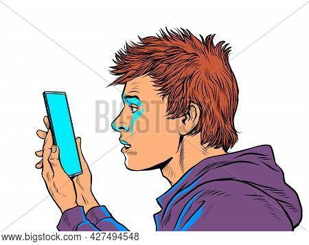 A Teenage Guy And A Smartphone. Internet And Apps
