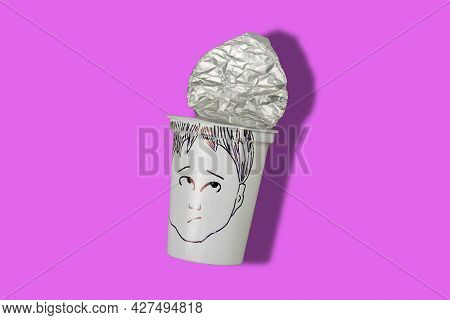 Transitional Stage Of Adolescence Concept. Empty Yogurt Cup With A Young Man's Face Painted On A Col