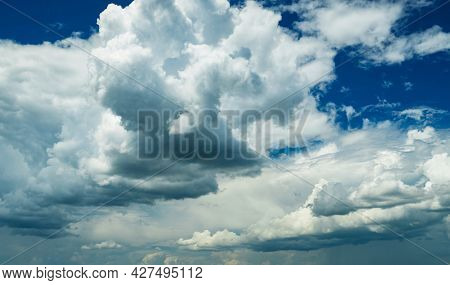 beautiful blue sky and bright clouds as abstract background