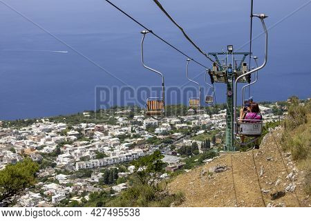 Capri Island, Italy - June 28, 2021: Chairlift To Monte Solaro, View Of The High Chairs With Tourist
