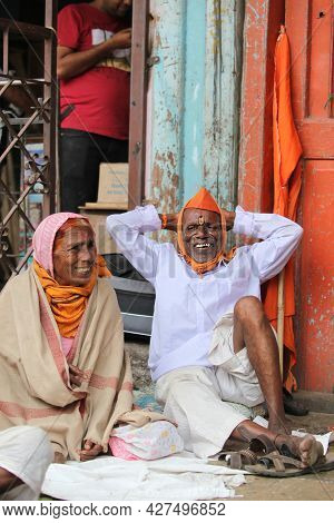 Pune, India - July 11, 2015: A Elderly Indian Pilgrim Couple Resting On Their Way To Pilgrimmage.