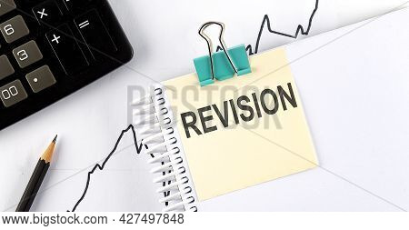 Stickers With Pencils And Notebook With Text Revision On The Wooden Background