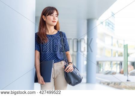 Happy Young Attractive Asian Business Woman In Casual Clothes Standing Leaning Against A Building, H