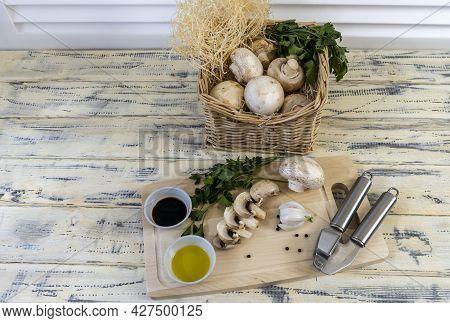Still Life, Food Photo Of Mushrooms Champignons. Mushrooms Are Whole And Chopped, Basket With Mushro