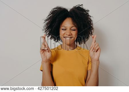 Portrait Of Pretty Cheerful African Girl Standing Isolated Over White Studio Background With Copy Sp