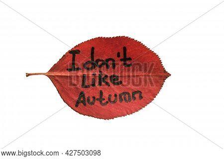 Leaf With Inscription Text - I Don't Like Autumn. Red Leaf Isolated On White Background Symbolizing