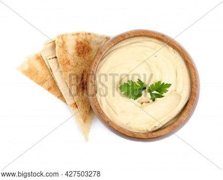 Delicious Hummus With Pita Chips And Parsley On White Background, Top View