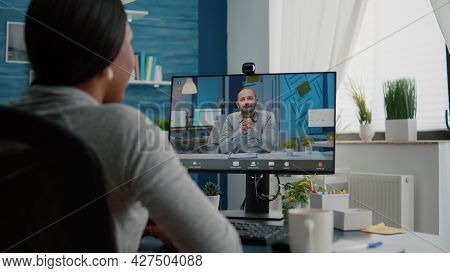 Closeup Of Student Talking With Entrepreneur Discussing Marketing Ideas Having Videocall Meeting Con
