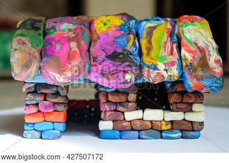 Multi-colored Voluminous Plasticine House From Small Piece Block Elements. Kid Toy. Side View.