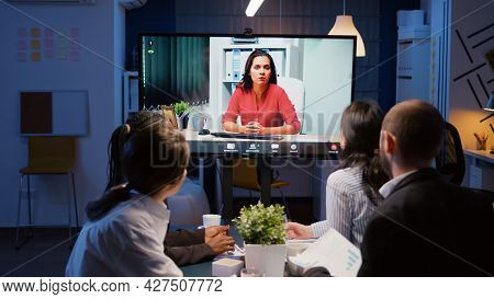 Diverse Multi-ethnic Businesspeople Discussing Management Strategy During Online Videocall Meeting C