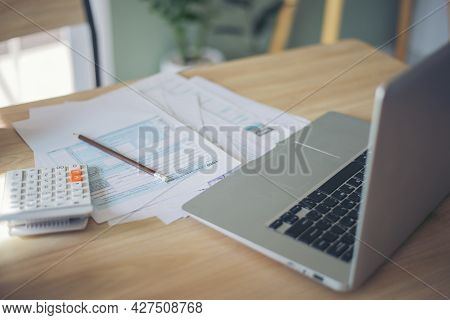 Individual Income Tax Return Form, Laptop, And Calculator For Who Have Income According To United St