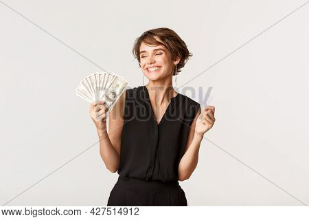 Successful Elegant Woman Smiling Pleased, Showing Money And Credit Card