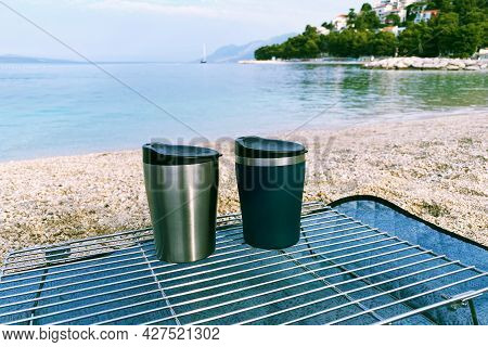 Tourist Food For Outdoor Activities. Two Metal Thermo Cups On A Summer  Background. Enjoy A Tasty Fo