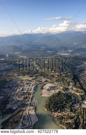 Aerial View From Airplane Of A Small Touristic Town, Squamish. Sunny Summer. Located In Howe Sound,