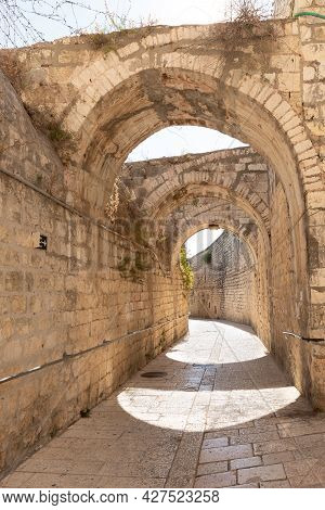 Stone Arched Connections On The Quiet Small St James Street In The Armenian Quarter In The Old City