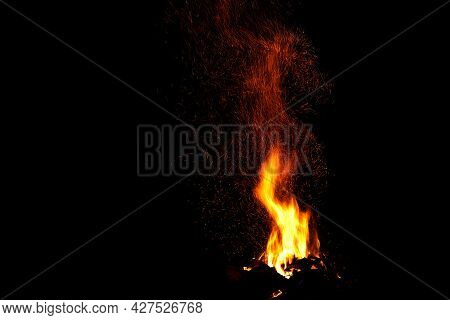Amazing Bonfire With Beautiful Yellow And Orange Spurts Of Flames And A Huge Sheaf Of Sparks In The