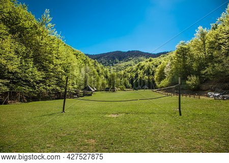 Volleyball court on a green meadow in beautiful bosnian mountains, Bjelasnica. Bosnia and Herzegovina.