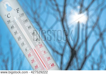 The Thermometer Lies On The Snow And Shows A Negative Temperature In Cold Weather On The Blue Sky.me