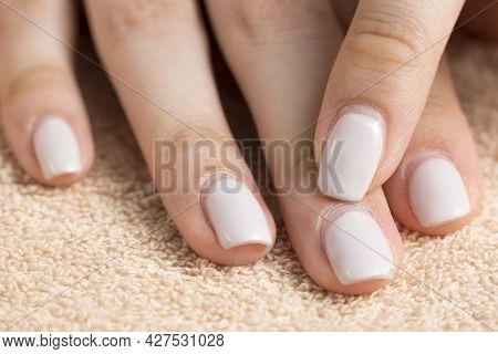 An Old Manicure. Overgrown Nail Polish. Manicure Correction. Nail Care. Beauty Salon, Spa, Procedure