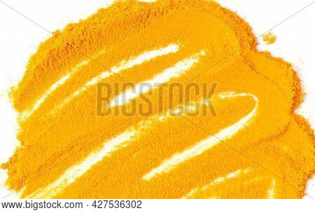 Dry Organic Turmeric Powder Or Curcuma Isolated On White Background Top View