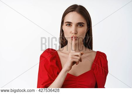 Hush Dont Speak. Young Beautiful Woman In Red Dress Tell To Keep Quiet, Taboo Gesture, Press Finger