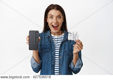 Wow Look At This Online Sale. Excited Woman Showing Her Smartphone Screen, Mobile App Interface And