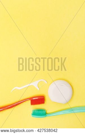 Teeth Hygiene And Oral Dental Care Products. Morning Concept. Vertical. Yellow Background. Oral Care