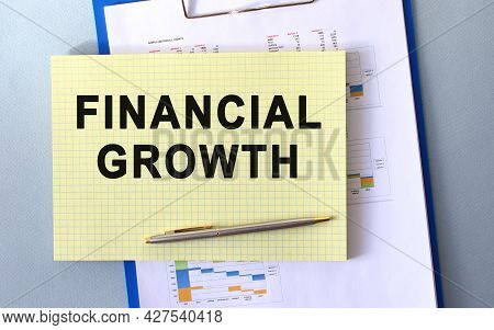 Financial Growth Text Written On Notepad With Pencil. Notepad On A Folder With Diagrams. Financial C