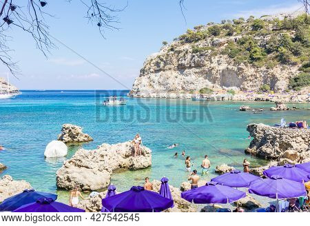 Rhodes, Greece - September 2018: Tourists On Beach Of Anthony Quinn Bay