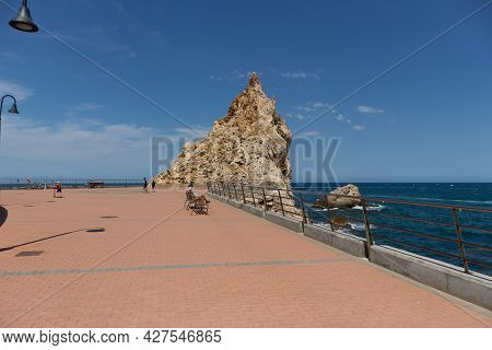 L'estartit, Spain - 26 June 2021 - Small Square In Front Of The Sea And Huge Rocks In Front. People