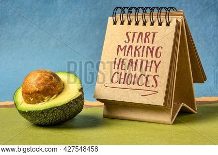start making healthy choices motivational reminder - handwriting in a desktop calendar with avocado, lifestyle and personal development concept