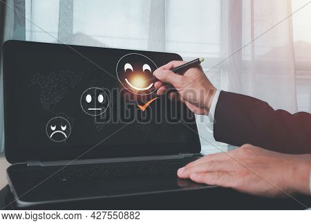 A Man Uses The Laptop And Chooses A Face Smile Emoticon To Show On The Virtual Screen. The Survey, P
