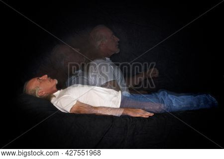 A Unique Multi Flash Image Of Man Lying Down And Rising Representing The Soul Leaving The Body Or As