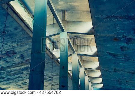 industrial warehouse or commercial area in an architectural background with bare cement  pillars supporting a ceiling before construction