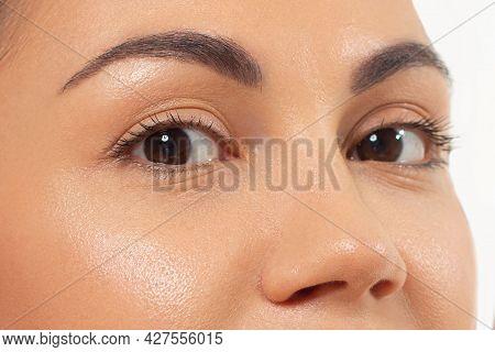 Close-up Of Woman's Eyes With Nude Make-up. Fashionable Shades Of Eye Shadow, Extremely Long Eyelash