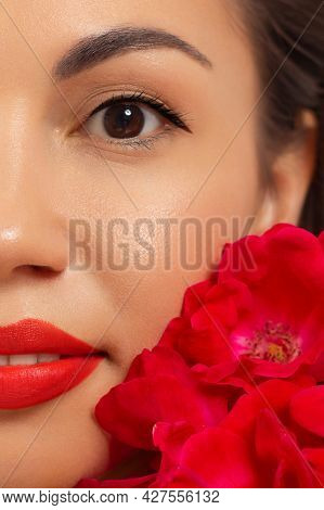 Close-up Beauty Of Half Female Face With Creative Fashion Evening Make-up. Black Arrows On The Eyes